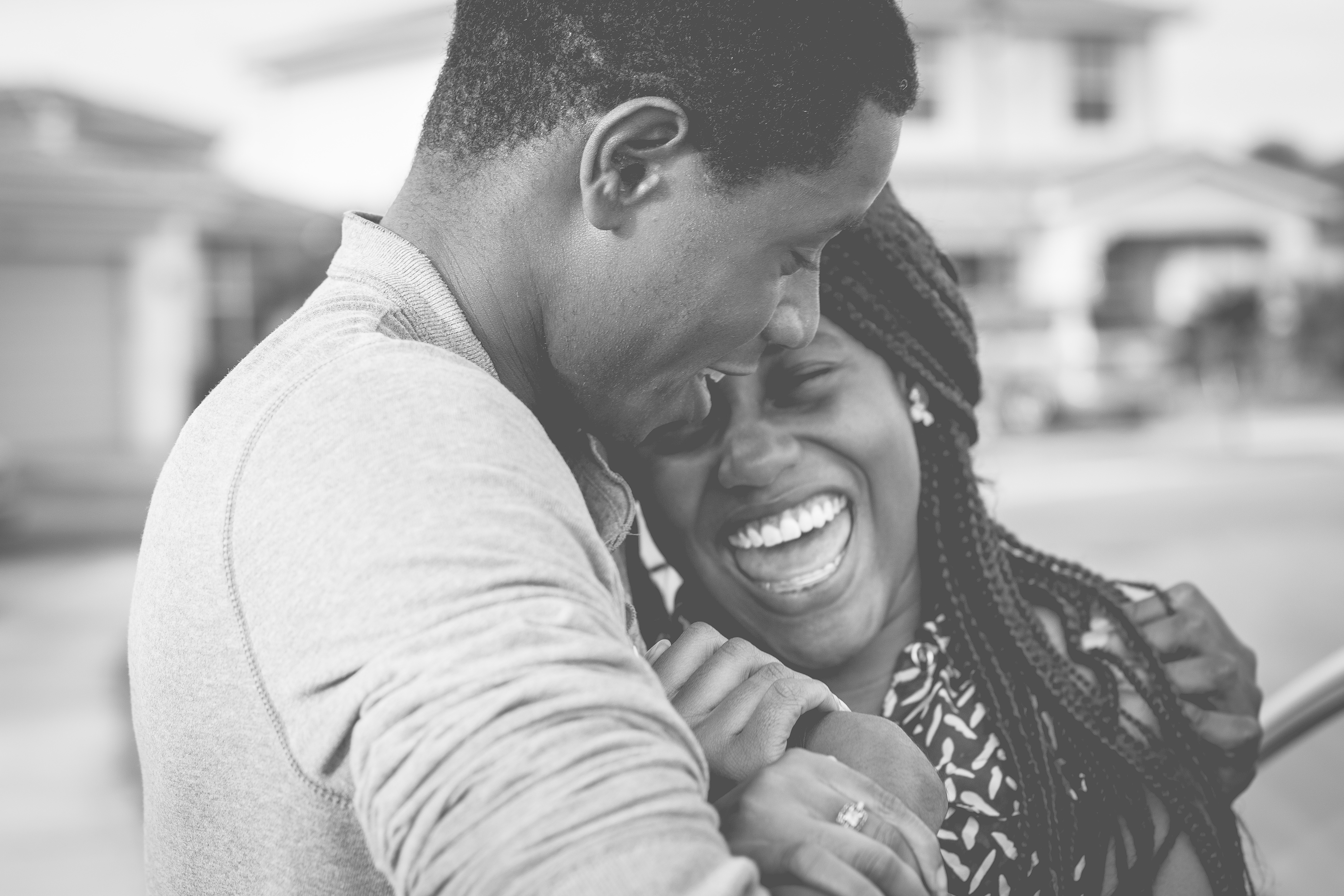 A young couple embracing and laughing